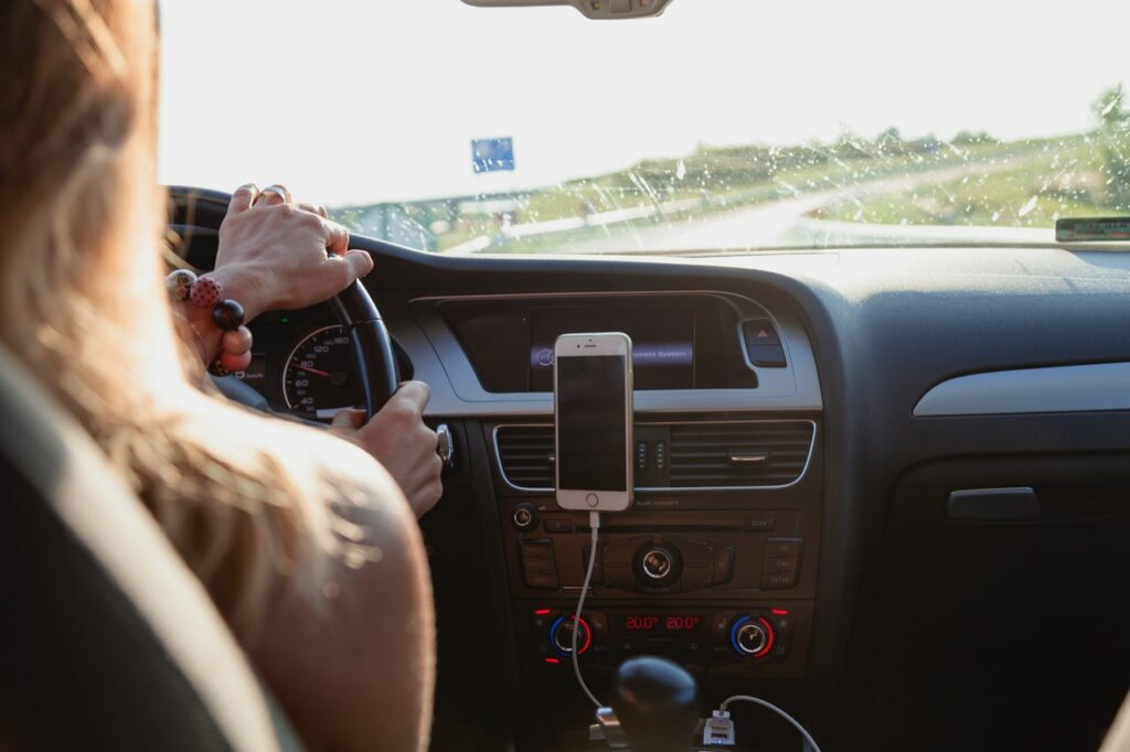 Woman Driving with Cell Phone GPS - Summer Road Trip
